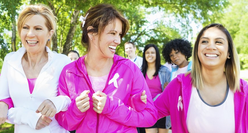 Women breast cancer supporters that are jogging.