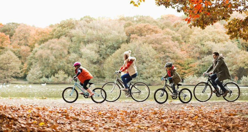 family cycling safely with hospital indemnity insurance