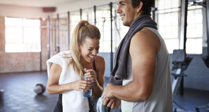 Couple doing heart healthy workout at gym