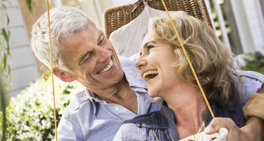 happy-couple-using-life-insurance-living-benefits